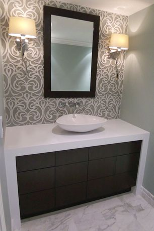 Contemporary Powder Room with European Cabinets, interior wallpaper, Corian counters, Crown molding, Vessel sink, Wall sconce