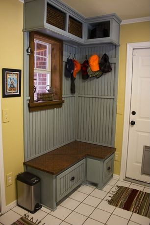 Cottage Mud Room with Built-in bookshelf, Pental bronzo polished granite, specialty door, Granite bench seat, Crown molding