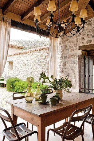 """Rustic Porch with Paint, Armless metal chairs, Lamps plus-alexander 8-light 38"""" wide wrought iron chandelier  style # u8457"""