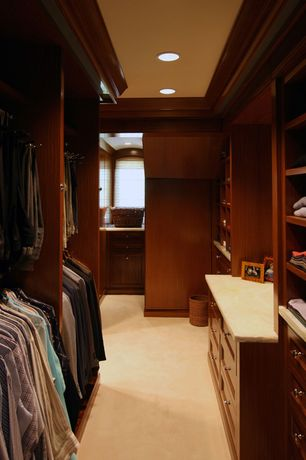 Traditional Closet with Built-in bookshelf, Concrete floors, Crown molding