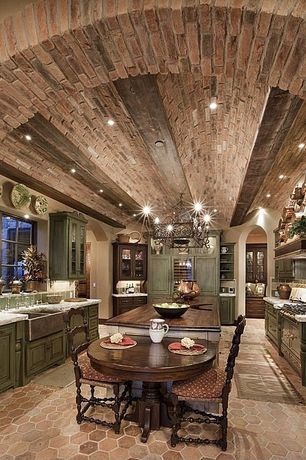 Country Kitchen with Built-in bookshelf, Mexican tile designs traditional mexican tile, Chandelier, Exposed brick ceiling