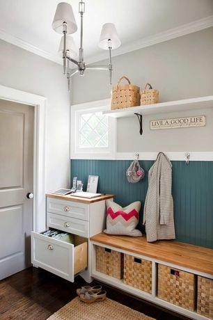 Cottage Mud Room with Paint 2, Chair rail, Built-in bookshelf, Chandelier, Paint 1, six panel door, Crown molding, Casement