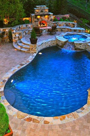 Mediterranean Swimming Pool with Pathway, Viking Free Form Pools, Exterior fireplace, exterior stone floors, Fence