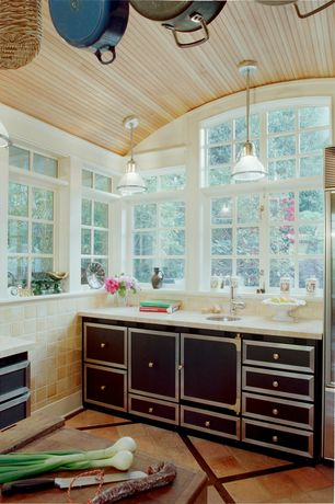 Eclectic Kitchen with partial backsplash, picture window, limestone tile floors, Undermount sink, Arched window, Stone Tile
