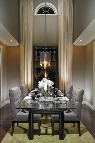 Contemporary Dining Room with Pendant light, High ceiling, Arched window, Laminate floors