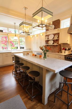 Traditional Kitchen with Complex marble counters, Pendant light, Inset cabinets, Breakfast bar, Wall sconce, Stone Tile