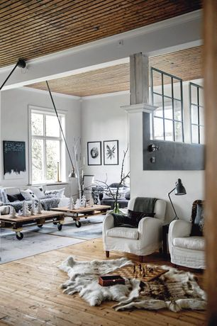 Contemporary Living Room with Casement, Columns, bedroom reading light, Pallet coffee table, Exposed beam, Paint