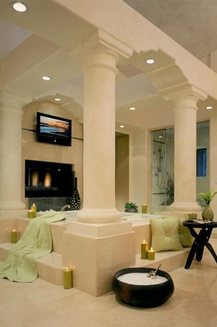 Traditional Master Bathroom with frameless showerdoor, Cathedral ceiling, Kohler underscore 4ft. air bath tub, Columns