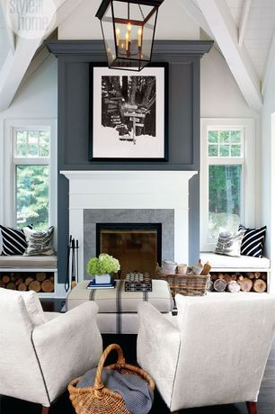 Cottage Living Room with High ceiling, Hardwood floors, Exposed beam, Black and white diagonal stripes. throw pillows