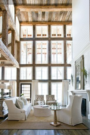Traditional Living Room with Hardwood floors, French doors, Painted wood panel wall, Exposed beam, Hardwood flooring