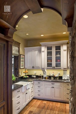Country Kitchen with Farmhouse sink, Casement, Simple Granite, Msi granite countertops in black spice, can lights, L-shaped