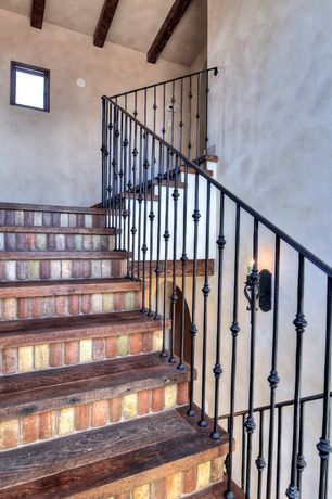Mediterranean Staircase with Exposed beam, Hardwood floors, Spiral staircase, High ceiling, Wall sconce