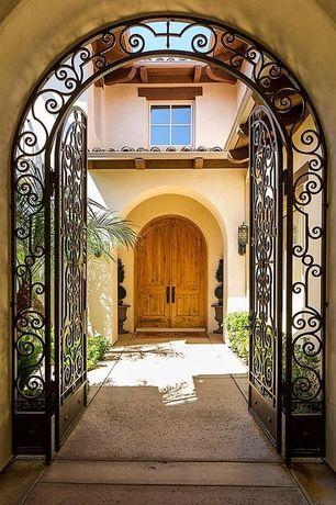 Mediterranean Front Door with exterior tile floors, Pathway, Gate, Arbor