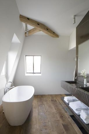 Modern Master Bathroom with Freestanding, Hardwood floors, Travertine counters, Driftwood beam detail, flush light