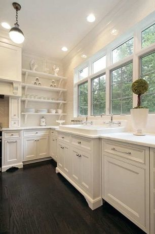 Traditional Kitchen with Limestone counters, Pendant light, Farmhouse sink, Crown molding, L-shaped, Custom hood, Stone Tile