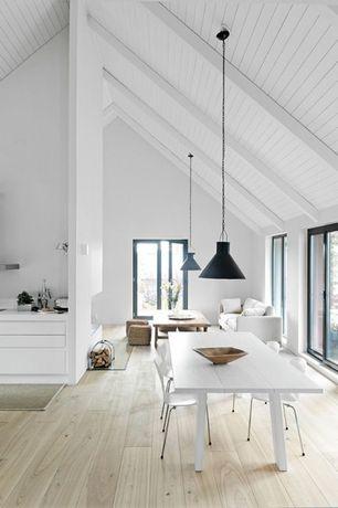Modern Dining Room with Standard height, Hardwood floors, Pendant light, Exposed beam, sliding glass door, Casement