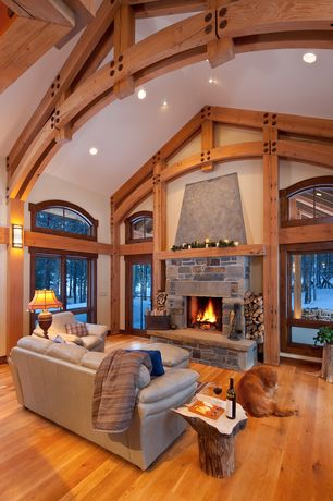 Country Great Room with Dering hall tree stump table, stone fireplace, French doors, Exposed beam, Wall sconce, High ceiling