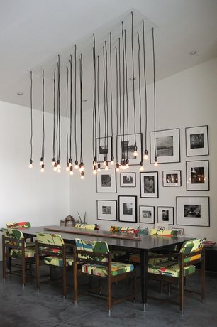 Modern Dining Room with Standard height, Concrete floors, Pendant light, can lights