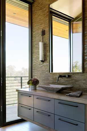 Contemporary Master Bathroom with Travertine counters, specialty door, Elements of design concord wall mounted faucet, Flush