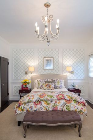 Traditional Master Bedroom with Wainscotting, specialty door, Chair rail, Crown molding, Chandelier, Hardwood floors