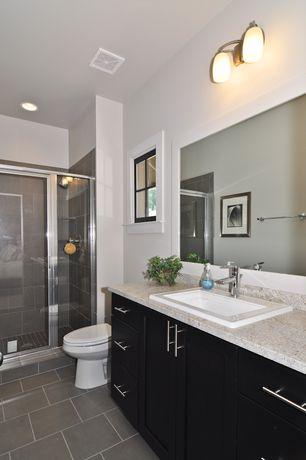 Modern Master Bathroom with Arizona tile cebu aqua porcelain tile, European Cabinets, Simple granite counters, Wall sconce