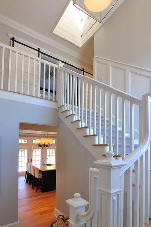 Traditional Staircase with Loft, Hardwood floors, Chair rail, Barn door, Crown molding, Skylight, flush light, Wainscotting