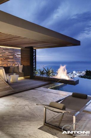 Contemporary Patio with Infinity pool, Fire pit, exterior stone floors