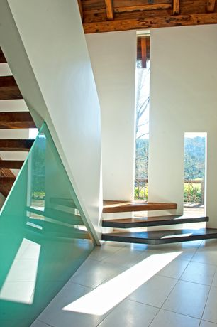 Contemporary Staircase with High ceiling, Concrete tile , Exposed beam