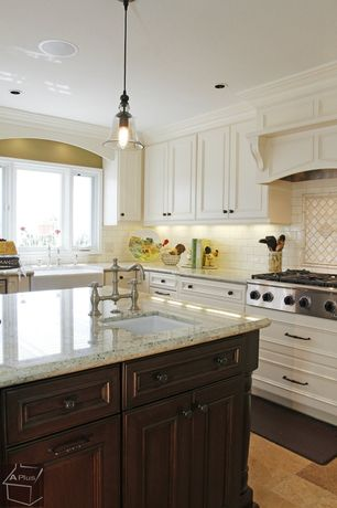 Traditional Kitchen with L-shaped, Subway Tile, Simple granite counters, Flat panel cabinets, limestone tile floors