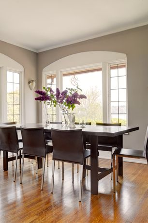 Modern Dining Room with Hardwood floors, Casement, Standard height, Wall sconce