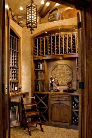Mediterranean Wine Cellar with High ceiling, slate floors, can lights, Pendant light, French doors