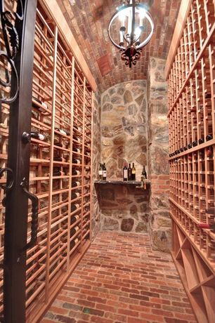 Mediterranean Wine Cellar with Designer series 12-bottle vertical wine display cabinet, Chandelier, Brick floors