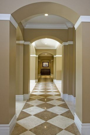 Traditional Hallway with can lights, Standard height, Wainscotting, Columns, Crown molding, Concrete tile