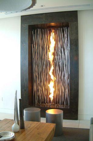 Modern Living Room with Pendant light, sandstone tile floors, Cement fireplace