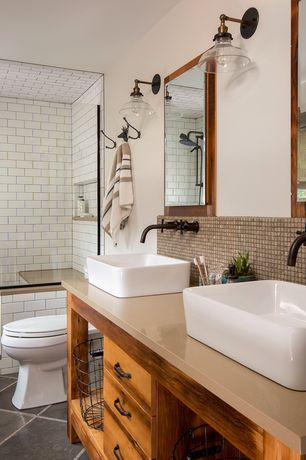 Eclectic Master Bathroom with Double sink, Wall sconce, Soapstone counters, Flush, Master bathroom, frameless showerdoor