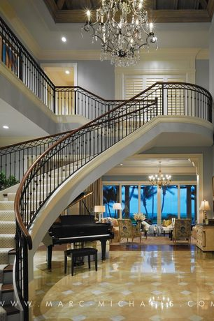 Traditional Staircase with Exposed beam, Wood and iron railing, Baby grand piano, Cathedral ceiling, Crown molding, Loft