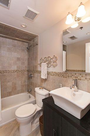 Traditional Full Bathroom with Vessel sink, European Cabinets, specialty door, MS International Jania Cream Limestone, Flush