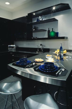 Modern Kitchen with Framed Partial Panel, stone tile floors, Stainless Steel Countertops, Undermount sink, built-in microwave
