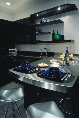 Modern Kitchen with Stilnovo ABS001 Tractor Stool, Undermount sink, Corian Solid Surface Countertop in Deep Nocturne