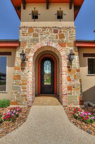 Mediterranean Exterior of Home with Pathway, Glass panel door