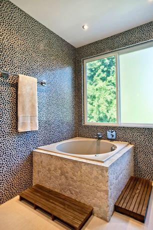 Modern Master Bathroom with can lights, Bathtub, Standard height, stone tile floors, drop in bathtub, Master bathroom