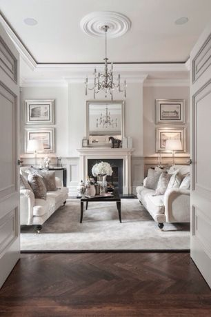 Traditional Living Room with French doors, Chandelier, Wainscotting, Crown molding, Fireplace, Paint 1, Wall frame molding