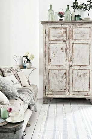 Eclectic Living Room with Crown Top Painted Distressed Old Door Armoire, Hardwood floors, High ceiling