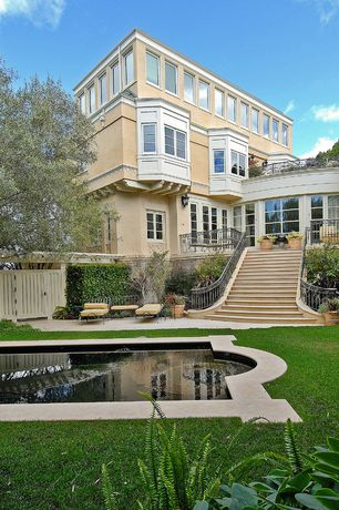 Traditional Swimming Pool with French doors, Pathway, picture window, Fence, exterior stone floors, Bay window, Deck Railing