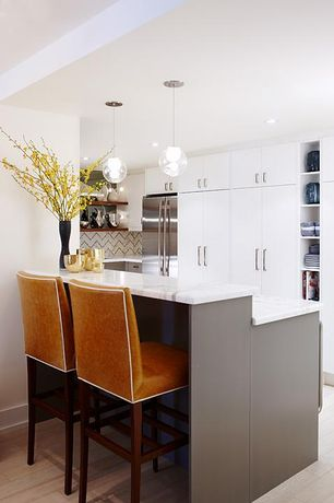 "Contemporary Kitchen with Kitchen peninsula, Pendant light, Complex marble counters, 11"" globe pendant, Herringbone Tile"