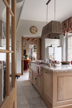 Country Kitchen with stone tile floors, Inset cabinets, Farmhouse sink, Natural wood finish, Breakfast nook, London shades