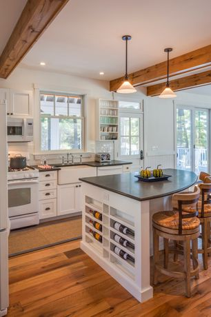 Country Kitchen with Exposed beam, gas range, Standard height, Quartz counters, full backsplash, Flush, L-shaped, dishwasher