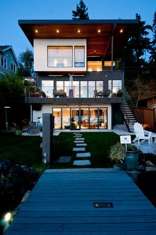 Modern Exterior of Home with Exterior stone pathway, Outdoor seating, Fence, Gray Square Patio Stone, Outdoor kitchen