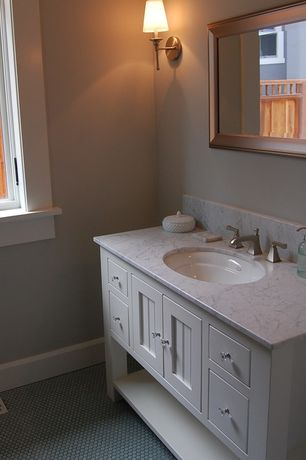 Traditional Powder Room with European Cabinets, Travertine counters, Casement, partial backsplash, penny tile floors, Paint