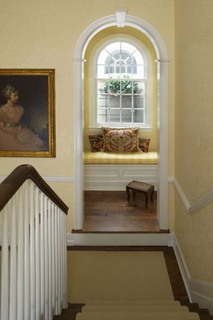 Traditional Staircase with High ceiling, Stairway runner, Corbel, curved staircase, Paint, Chair rail, Hardwood floors